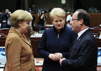 German Chancellor Merkel talks with French President Hollande and Lithuanian President Grybauskaite during a European Union leaders summit discussing the EU's long-term budget in Brussels