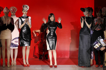 Portuguese designer Fatima Lopes appears surrounded by models at the end of her Fall/Winter 2012-2013 women's ready-to-wear fashion show during Paris fashion week