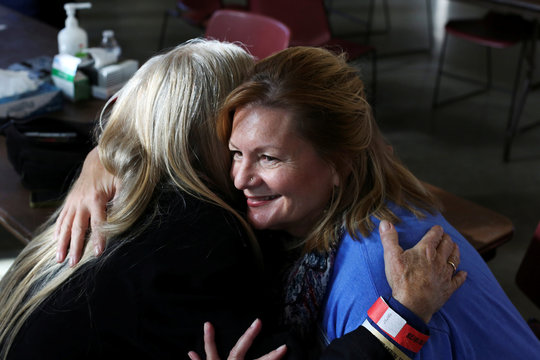 Optician Ginny Mercer hugs Kanti Kish after helping her select a pair of free eyeglasses during the Seattle/King County Clinic, a four-day event offering free dental, vision, and medical care, at Key Arena in Seattle, Washington