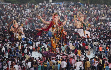 Devotees gather around the idols of Hindu elephant god Ganesh, the deity of prosperity, before they are carried for immersion into the Arabian Sea on the last day of the Ganesh Chaturthi festival in Mumbai