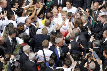 Pope Francis greets youths after leading the Palm Sunday mass at Saint Peter's Square in the Vatican