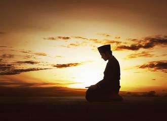 Young asian muslim man worshiped praying to god