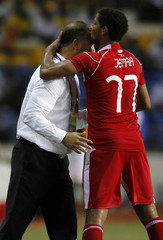 Tunisia's Issam kisses his coach Samir Trabelssi as he celebrates his goal during their African Cup of Nations soccer match against Niger in Libreville