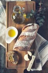 French country bread, round cheese and olive oil. Toned image