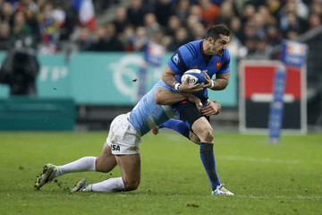 France's Scott Spedding is tackled by Argentina's Marcelo Bosch during their rugby union test match at the Stade de France in Saint-Denis near Paris