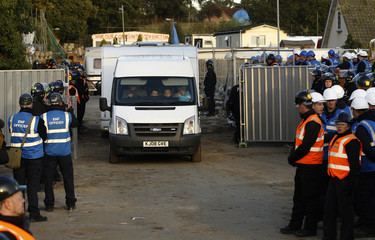 Travellers leave the Dale Farm travellers' site, near Billericay in southern England