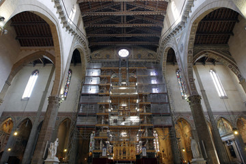 Scaffolding shroud the 600-year-old frescoes of the Capella Maggiore in the Florence's  Santa Croce Basilica