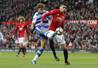 Manchester United's Chris Smalling in action with Reading's Daniel Williams