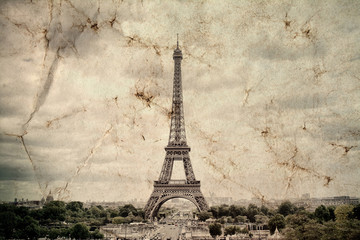 Eiffel Tower in Paris. Vintage view background. Tour Eiffel old retro style photo with cracks crumpled paper. Postcard style.
