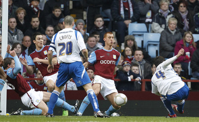 Elphick of Brighton and Hove Albion scores against Aston Villa during their English FA Cup soccer match at Villa Park in Birmingham
