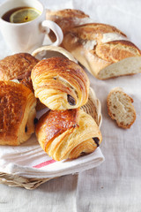 French pastry:  puff chocolate buns, baguette and cup of tea