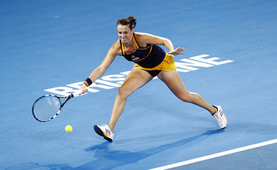 Pavlyuchenkova of Russia hits a return to Williams of the U.S. during their women's final match at the Brisbane International tennis tournament