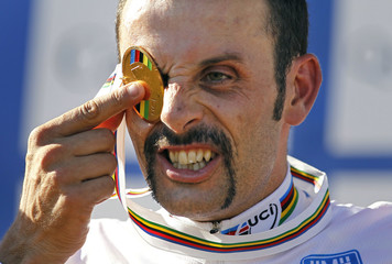 Spain's Ramos covers his eye with his medal after winning the men's cross country at the UCI Mountain Bike World Championships in Mount Ste-Anne