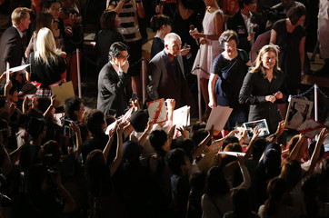 Hollywood actor Brad Pitt walks red carpet as he gives his autograph to fans in Tokyo