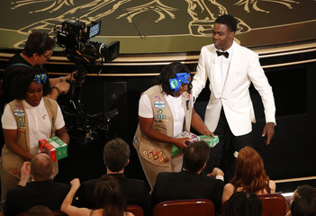 Show host Chris Rock sells Girl Scout cookies during the 88th Academy Awards in Hollywood