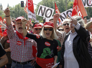 Demonstrators shout slogans during a protest against the labour reform of the Spanish government in Madrid