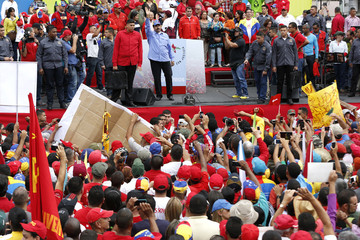 Venezuelan President Nicolas Maduro waves to supporters during a rally to commemorate the 57th anniversary of the end of Venezuelan dictator Marcos Perez Jimenez's regime in Caracas