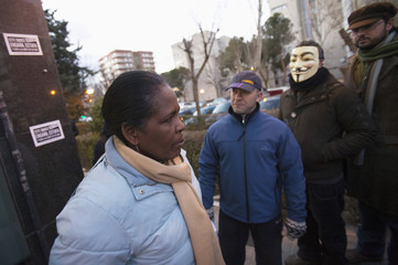 Pinales stands in front of bank office after requesting for dation in payment for her house in Mostoles, near Madrid