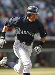 Mariners right fielder Ichiro Suzuki singles against the Rangers in the first inning during a spring training baseball game in Surprise