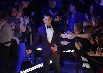 Canadian musician and host Buble arrives on stage during the Juno Awards show in Regina.