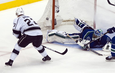 Los Angeles Kings Brown scores on Vancouver Canucks goalie Luongoduring their NHL Western Conference quarter-final hockey playoff in Vancouver