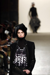A model presents a creation from the 3.1 Phillip Lim Autumn/Winter 2013 collection during New York Fashion Week