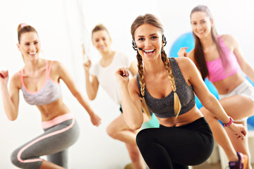 Group of smiling people doing aerobics