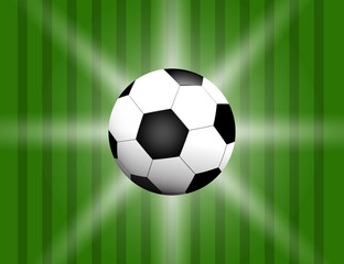 Football / soccer Ball Isolated on Green Background with Space for Your Text.