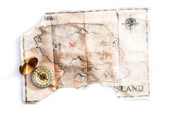 Folded vintage map of fake island with Pirates Treasure chest and compass