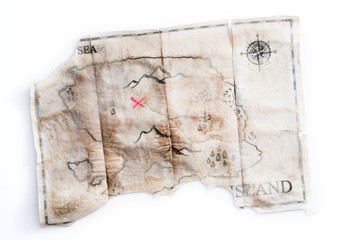 Folded vintage map of fake island with Pirated treasure chest