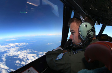 Flight Lieutenant Adams looks out from cockpit of a RAAF aircraft during search for missing Malaysia Airlines Flight MH370