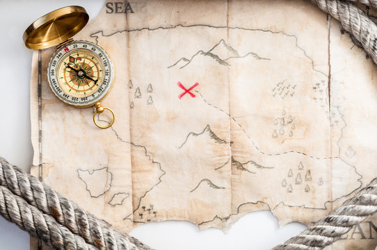 Top view to Fake treasure map with red cross and Marine rope
