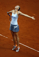 Russia's top seed and holder Sharapova celebrates her victory against China's Li in the final of the Stuttgart tennis Grand Prix