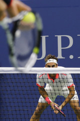 Federer of Switzerland awaits serve from Djokovic of Serbia during their men's singles final match at the U.S. Open Championships tennis tournament in New York