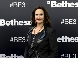 Actress Lynda Carter poses during a media briefing by game publisher Bethesda Softworks before the opening day of the Electronic Entertainment Expo in Los Angeles, California