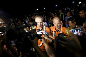 Swiss pilots Bertrand Piccard and Andre Boschberg talk to the media after Piccard landed the Solar Impulse 2 at Mandalay International Airport