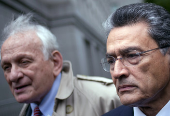 Rajat Gupta leaves the U.S. District Court with his lawyer Gary Naftalis after he was sentenced in Manhattan, New York