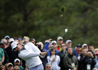 Northern Ireland's Rory McIlroy hits off the 12th tee during a practice round at the Augusta National Golf Club in Augusta