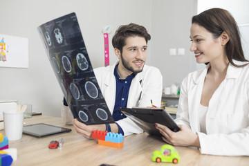 Doctor,pediatrician exam MRI results