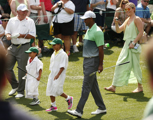 U.S. golfer Woods walks down the fairway with his children along with his girlfriend Vonn and his playing partner O'Meara during the par 3 event held ahead of the 2015 Masters at Augusta National Golf Course in Augusta