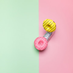 Minimal concept Bright donuts on a pink and green Pastel Background. Creative Handset
