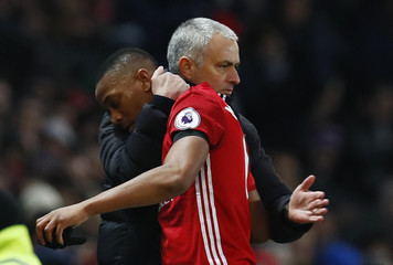Manchester United's Anthony Martial is congratulated by manager Jose Mourinho as he is substituted
