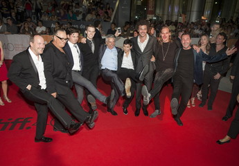 """Cast members pose as they arrive on the red carpet for the film """"Stonewall"""" during the Toronto International Film Festival in Toronto"""