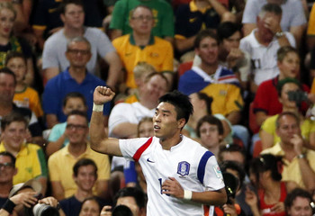 South Korea's Lee Jeong-hyeop celebrates after scoring a goal against Australia during their Asian Cup Group A soccer match at the Brisbane Stadium in Brisbane