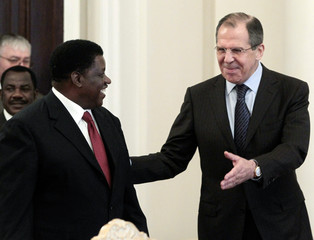 Russian Foreign Minister Lavrov gestures to his Namibian counterpart Nujoma during their meeting in Moscow