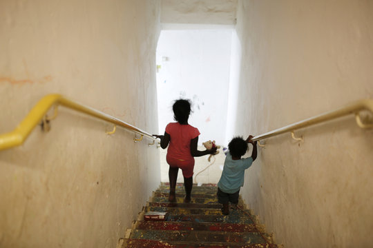Israeli girls go down the stairs into a bomb shelter in the Israeli southern city of Ashkelon