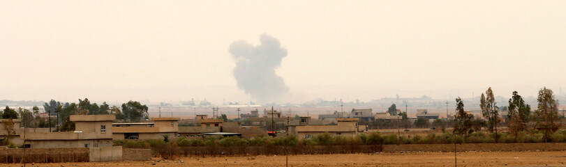 Smoke rises after a  U.S airstrike targets a location near Bartella during a battle with Islamic State militants