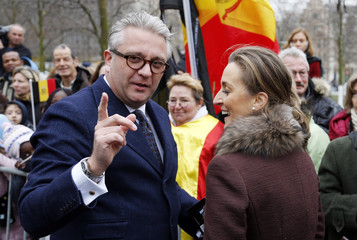 Belgium's Prince Laurent and Princess Claire leave a Te Deum mass on the occasion of King's Day at the Saint-Gudule cathedral in Brussels