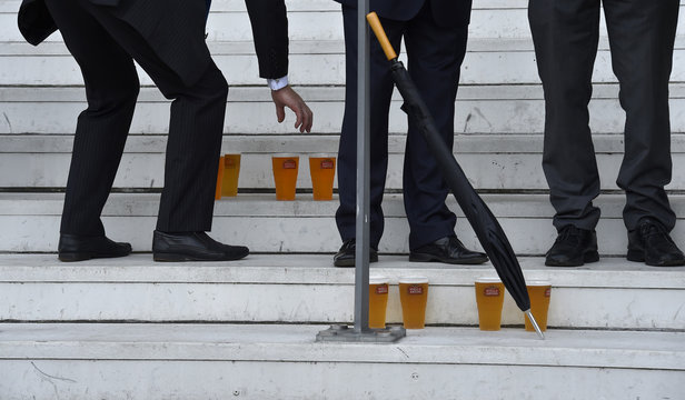 FILE PHOTO -  A racegoer reaches for his beer at Royal Ascot