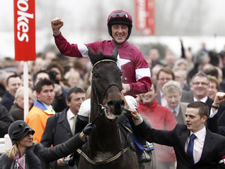 Davy Russell on Sir des Champs celebrates winning the Novices' Chase at the Cheltenham Festival horse racing meet in Gloucestershire